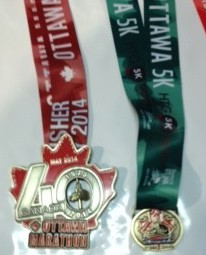 Ottawa Race Weekend Marathon and 5k medals.