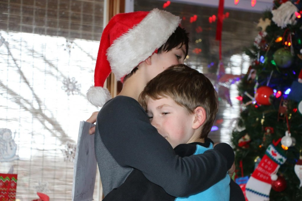 Christmas miracles come in many forms - like your kids giving each other hugs!
