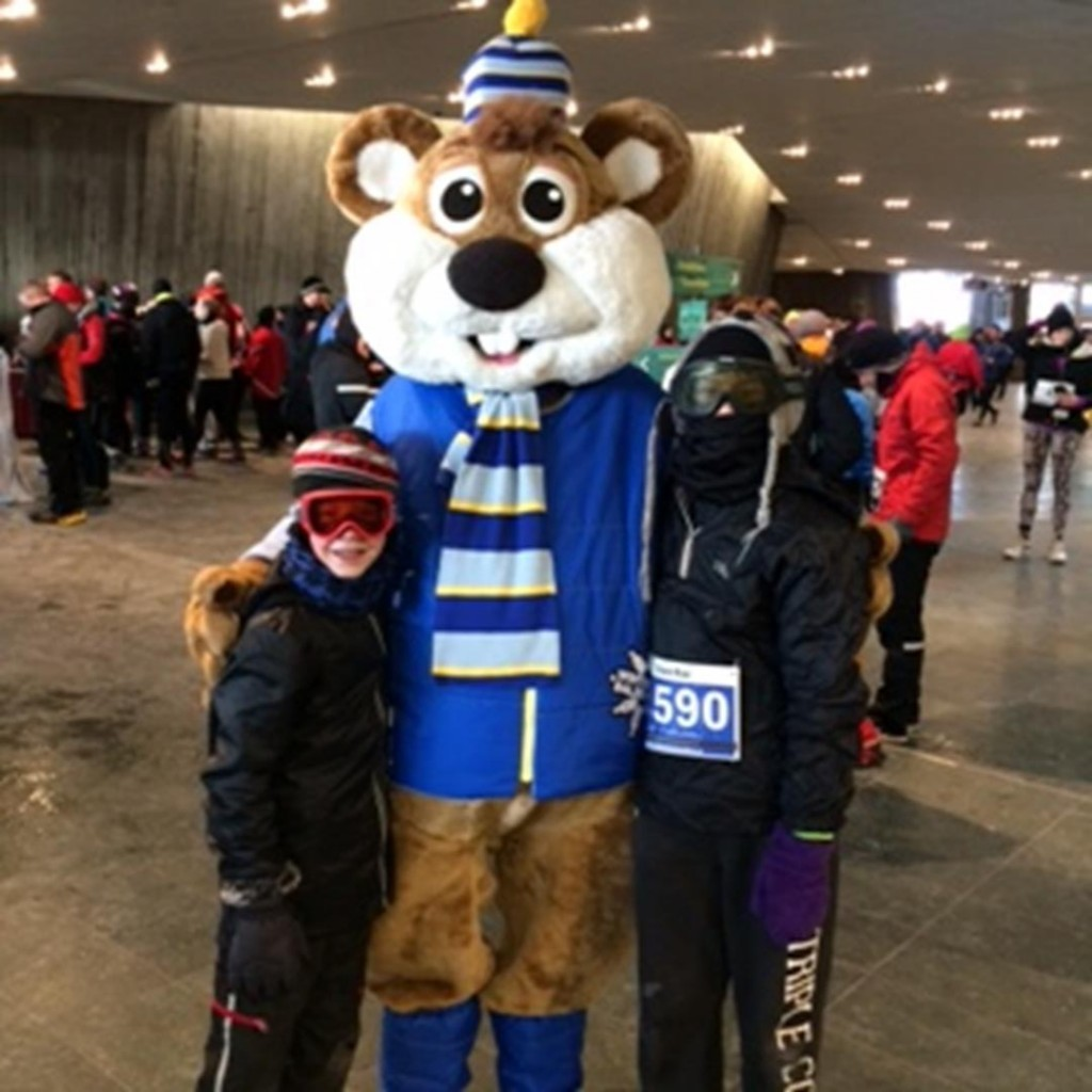 The kids bundled up alongside the Winterlude mascot.